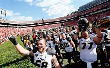 ATHENS, GA - OCTOBER 12:  The Missouri Tigers celebrate their 41-26 win over the Georgia Bulldogs at Sanford Stadium on October 12, 2013 in Athens, Georgia.  (Photo by Kevin C. Cox/Getty Images) By Kevin C. Cox