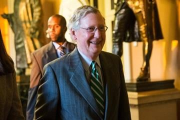 Who's racing to forge deal to avert default?  Reid and McConnell, longtime Senate antagonists, are discussing plans to raise the debt limit until mid-February and halt the two-week-old government shutdown. By Andrew Burton
