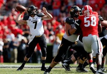 ATHENS, GA - OCTOBER 12:  Maty Mauk #7 of the Missouri Tigers looks to pass against the Georgia Bulldogs at Sanford Stadium on October 12, 2013 in Athens, Georgia.  (Photo by Kevin C. Cox/Getty Images) By Kevin C. Cox