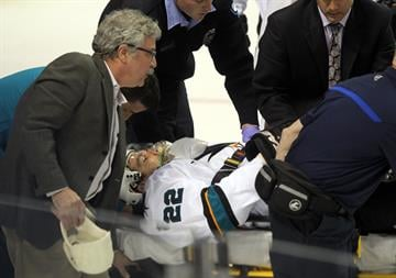 San Jose Sharks Dan Boyle is taken from the ice by stretcher after being injured in the first period against the St. Louis Blues at the Scottrade Center in St. Louis on October 15, 2013.    UPI/Bill Greenblatt By BILL GREENBLATT