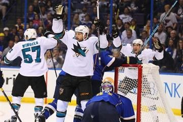 ST. LOUIS, MO - OCTOBER 15:  Andrew Desjardins #10 of the San Jose Sharks celebrates a goal against the St. Louis Blues at the Scottrade Center on October 15, 2013 in St. Louis, Missouri.  (Photo by Dilip Vishwanat/Getty Images) By Dilip Vishwanat