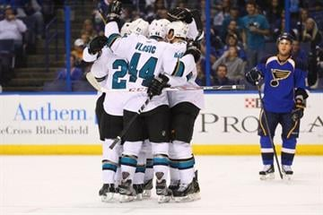 ST. LOUIS, MO - OCTOBER 15:  Members of the San Jose Sharks celebrate after scoring a goal against the St. Louis Blues at the Scottrade Center on October 15, 2013 in St. Louis, Missouri.  (Photo by Dilip Vishwanat/Getty Images) By Dilip Vishwanat