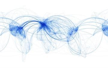 Airline routes are mapped across the globe. Certain areas of the world receive much more traffic as glimpses of geography come into view.