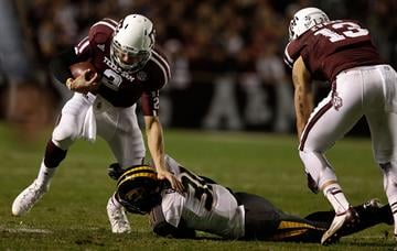 COLLEGE STATION, TX - NOVEMBER 24:  Johnny Manziel #2 of the Texas A&M Aggies is taken down by E.J. Gaines #31 of the Missouri Tigers at Kyle Field on November 24, 2012 in College Station, Texas.  (Photo by Scott Halleran/Getty Images) By Scott Halleran