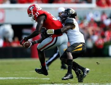 ATHENS, GA - OCTOBER 12:  Chris Conley #31 of the Georgia Bulldogs pulls in this reception against John Gibson #1 of the Missouri Tigers at Sanford Stadium on October 12, 2013 in Athens, Georgia.  (Photo by Kevin C. Cox/Getty Images) By Kevin C. Cox