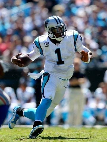 CHARLOTTE, NC - SEPTEMBER 22:  Cam Newton #1 of the Carolina Panthers during their game at Bank of America Stadium on September 22, 2013 in Charlotte, North Carolina.  (Photo by Streeter Lecka/Getty Images) By Streeter Lecka