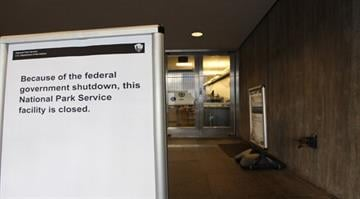 A sign indicating they are closed greets visitors at the Gateway Arch in St. Louis on October 1, 2013. The Arch and other National Parks throughout the United States are closed due to the federal government shutdown. UPI/Bill Greenblatt By BILL GREENBLATT