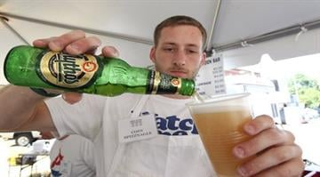 Cody Spitznagle pours a Mythos greek beer in the beer garden at the Greek Festival in St. Louis on September 2, 103. The annual festival drew record numbers for a single day due to the cooler weather. UPI/Bill Greenblatt By BILL GREENBLATT