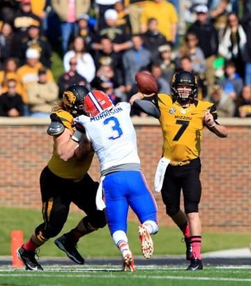 COLUMBIA, MO - OCTOBER 19:  Quarterback Maty Mauk #7 of the Missouri Tigers passes during the game against the Florida Gators at Faurot Field/Memorial Stadium on October 19, 2013 in Columbia, Missouri.  (Photo by Jamie Squire/Getty Images) By Jamie Squire