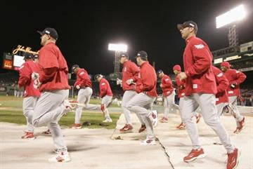 BOSTON - OCTOBER 23:  Members of the St. Louis Cardinals warm up before game one of the World Series against the Boston Red Sox on October 23, 2004 at Fenway Park in Boston, Massachusetts. (Photo by Elsa/Getty Images) By Elsa