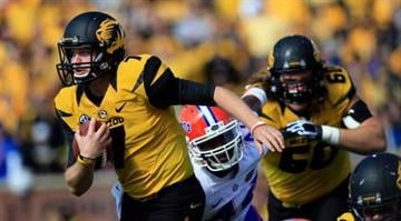 Maty Mauk, who made his first college start on Saturday, threw for 295 yards and a touchdown while adding a touchdown on a ground in the Tigers' 36-17 win over the Florida Gators. By Brendan Marks