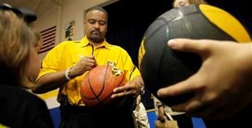 In this April 28, 2011 photo, Missouri mens basketball coach Frank Haith signs a basketball for a young fan at a Tiger Caravan event in Mendon, Mo. (AP Photo/Charlie Riedel) By Charlie Riedel