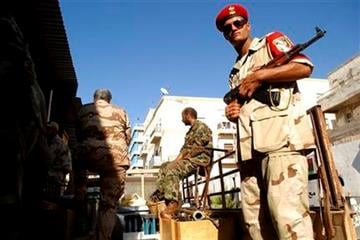 Libya falls deeper into anarchy.  Rival Islamist and Western-backed factions are melding with the country's dizzying array of militias, turning political feuds into armed conflict. By Ibrahim Alaguri