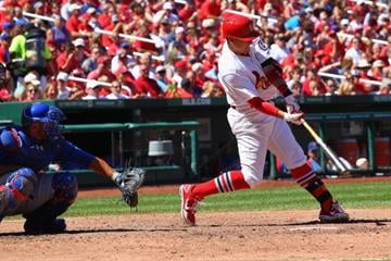 ST. LOUIS, MO - AUGUST 11: Allen Craig #21 of the St. Louis Cardinals singles against the Chicago Cubs in the first inning at Busch Stadium on August 11, 2013 in St. Louis, Missouri.  (Photo by Dilip Vishwanat/Getty Images) By Dilip Vishwanat