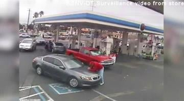 Surveillance video from a Nevada gas station shows a victim getting clipped by a grey car following a road rage incident. By Stephanie Baumer