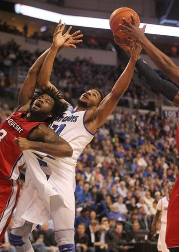 Saint Louis University Billikens Dwayne Evans (21) battles theDuquesne Dukes defense for the rebound in the first half at the Chaifetz Arena in St. Louis on February 27, 2014.    UPI/Bill Greenblatt By BILL GREENBLATT