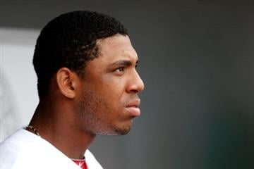 JUPITER, FL - FEBRUARY 28:  Oscar Taveras #87 of the St. Louis Cardinals looks on from the dugout against the Miami Marlins at Roger Dean Stadium on February 28, 2013 in Jupiter, Florida.  (Photo by Chris Trotman/Getty Images) By Chris Trotman
