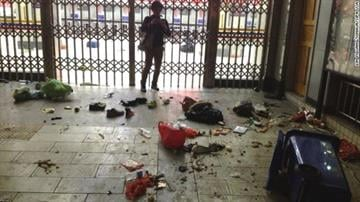 Luggage lies scattered inside the Kunming Railway Station in Kunming, the capital of southwest China's Yunnan Province, on Saturday, March 1, after an attack left at least 29 dead and more than 100 injured. By Elizabeth Eisele