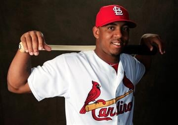 JUPITER, FL - FEBRUARY 24:  Oscar Taveras #77 of the St. Louis Cardinals poses for a portrait during photo day at Roger Dean Stadium on February 24, 2014 in Jupiter, Florida.  (Photo by Rob Carr/Getty Images) By Rob Carr