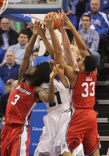 The Saint Louis University Billikens and Duquesne Dukes battle for the rebound in the second at the Chaifetz Arena in St. Louis on February 27, 2014.  Duquesne defeated the number eight Saint Louis 71-64.    UPI/Bill Greenblatt By BILL GREENBLATT