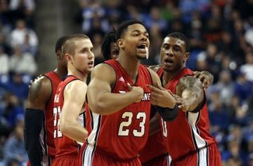 Duquesne Dukes Jeremiah Jones begins to celebrate their 71-64 win over the eighth ranked Saint Louis University Billikens in the last seconds of the game at the Chaifetz Arena in St. Louis on February 27, 2014.    UPI/Bill Greenblatt By BILL GREENBLATT