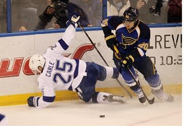 St. Louis Blues Alexander Steen upends Tampa Bay Lightning Matthew Carle in the first period at the Scottrade Center in St. Louis on March 4, 2014.  UPI/Bill Greenblatt By BILL GREENBLATT