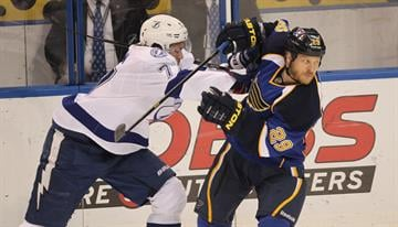 St. Louis Blues Steve Ott (29) gets turned around by Tampa Bay Lightning Victor Hedman in the first period at the Scottrade Center in St. Louis on March 4, 2014.  UPI/Bill Greenblatt By BILL GREENBLATT