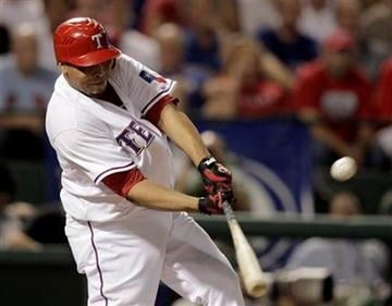 Texas Rangers' Nelson Cruz hits a double during the second inning of 