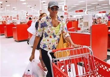 First lady Michelle Obama, wearing a hat and sunglasses, stands in line at a Target department store in Alexandria, Va., Thursday, Sept. 29, 2011, after doing some shopping.  (AP Photo/Charles Dharapak) By Charles Dharapak