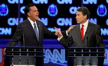Republican presidential candidates former Massachusetts Gov. Mitt Romney, left, and Texas Gov. Rick Perry speak during a Republican presidential debate Tuesday, Oct. 18, 2011, in Las Vegas. (AP Photo/Chris Carlson) By Chris Carlson