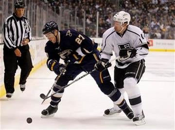 St. Louis Blues defenseman Alex Pietrangelo, left, tries to keep Los Angeles Kings right wing Justin Williams away from the puck during the first period of an NHL hockey game in Los Angeles, Tuesday, Oct. 18, 2011. (AP Photo/Jae C. Hong) By Jae Hong