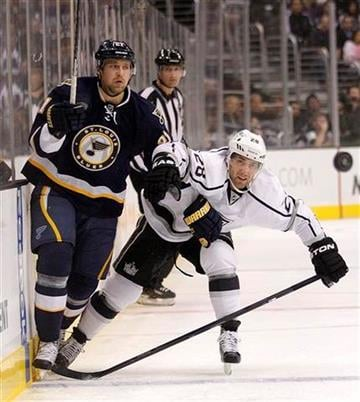 St. Louis Blues center Patrik Berglund, left, and Los Angeles Kings center Jarret Stoll go after the puck during the first period of an NHL hockey game in Los Angeles, Tuesday, Oct. 18, 2011. (AP Photo/Jae C. Hong) By Jae Hong