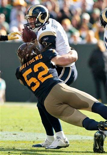 Green Bay Packers outside linebacker Clay Matthews (52) sacks St. Louis Rams quarterback Sam Bradford during the second half of an NFL football game Sunday, Oct. 16, 2011, in Green Bay, Wis. Green Bay won 24-3. (AP Photo/Mike Roemer) By Mike Roemer