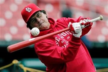 St. Louis Cardinals manager Tony La Russa hits during practice for Game 1 of baseball's World Series against the Texas Rangers Tuesday, Oct. 18, 2011, in St. Louis. (AP Photo/Charlie Riedel) By Charlie Riedel