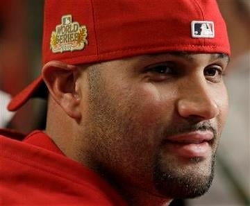 St. Louis Cardinals' Albert Pujols answers a question during a news conference before practice for Game 1 of baseball's World Series against the Texas Rangers Tuesday, Oct. 18, 2011, in St. Louis. (AP Photo/Paul Sancya) By Paul Sancya