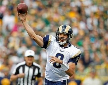 St. Louis Rams quarterback Sam Bradford (8) throws against the Green Bay Packers during the first half of an NFL football game Sunday, Oct. 16, 2011, in Green Bay, Wis. (AP Photo/Jeffrey Phelps) By Jeffrey Phelps