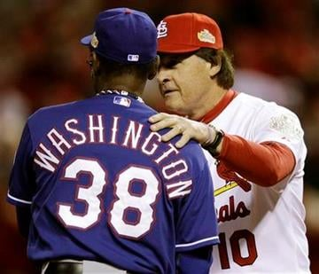 St. Louis Cardinals manager Tony La Russa shakes hands with Texas Rangers manager Ron Washington before Game 1 of baseball's World Series Wednesday, Oct. 19, 2011, in St. Louis. (AP Photo/Matt Slocum) By Matt Slocum