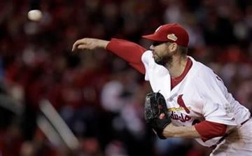 St. Louis Cardinals starting pitcher Chris Carpenter throws during the third inning of Game 1 of baseball's World Series against the Texas Rangers Wednesday, Oct. 19, 2011, in St. Louis. (AP Photo/Charlie Riedel) By Charlie Riedel