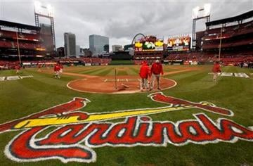 Workers prepare the field at Busch Stadium for Game 1 of baseball's World Series between the St. Louis Cardinals and the Texas Rangers Wednesday, Oct. 19, 2011, in St. Louis. (AP Photo/Paul Sancya) By Paul Sancya