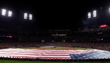 The US flag is show on the field during the national anthem before Game 1 of baseball's World Series between the St. Louis Cardinals and the Texas Rangers Wednesday, Oct. 19, 2011, in St. Louis. (AP Photo/Jeff Roberson) By Jeff Roberson