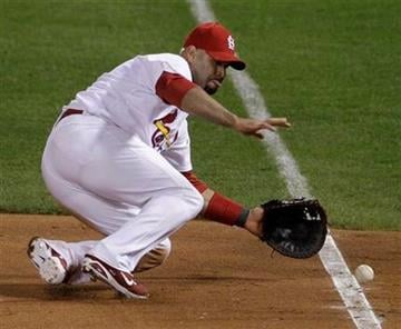 St. Louis Cardinals first baseman Albert Pujols makes a play on a ball hit by Texas Rangers' Michael Young during the sixth inning of Game 1 of baseball's World Series Wednesday, Oct. 19, 2011, in St. Louis. (AP Photo/Paul Sancya) By Paul Sancya