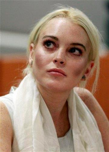 Lindsay Lohan is shown in court before being taken into custody by Los Angeles Country sheriffs deputies after a judge found her in violation of probation Wednesday, Oct. 19, 2011, in Los Angeles.  (AP Photo/Mark Boster, Pool) By Mark Boster