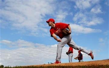 St. Louis Cardinals pitcher Adam Wainwright throws a bullpen session during spring training baseball Monday, Feb. 14, 2011, in Jupiter, Fla. (AP Photo/Jeff Roberson) By Jeff Roberson