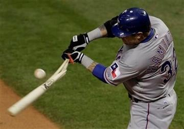 Texas Rangers' Josh Hamilton breaks his bat during the first inning of Game 2 of baseball's World Series against the St. Louis Cardinals Thursday, Oct. 20, 2011, in St. Louis. (AP Photo/Paul Sancya) By Paul Sancya