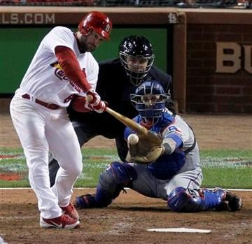 St. Louis Cardinals' Nick Punto singles off a pitch from Texas Rangers' Colby Lewis during the seventh inning of Game 2 of baseball's World Series Thursday, Oct. 20, 2011, in St. Louis. (AP Photo/Jeff Roberson) By Jeff Roberson