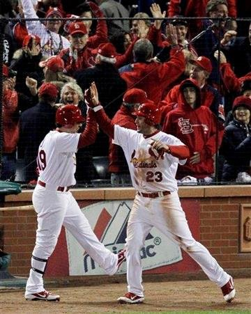 After scoring off a single from St. Louis Cardinals' Allen Craig, David Frees (23), reacts with Jon Jay during the seventh inning of Game 2 of baseball's World Series Thursday, Oct. 20, 2011, in St. Louis. (AP Photo/Jeff Roberson) By Jeff Roberson