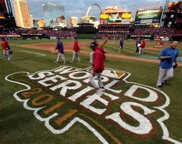 The Texas Rangers make their way off the field after batting practice before Game 2 of baseball's World Series against the St. Louis Cardinals Thursday, Oct. 20, 2011, in St. Louis. (AP Photo/Charlie Riedel) By Charlie Riedel