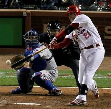 St. Louis Cardinals' Allen Craig hits a RBI single during the seventh inning of Game 2 of baseball's World Series against the Texas Rangers Thursday, Oct. 20, 2011, in St. Louis. (AP Photo/Jeff Roberson) By Jeff Roberson