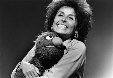 """In this 1973 photo, singer Lena Horne embraces the character Grover on during an appearance on the children's program """"Sesame Street,"""" in New York. (AP Photo/Sesame Workshop, Bill Pierce) By Bill Pierce"""