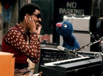 "In this 1973 image released by Sesame Workshop, singer Stevie Wonder teaches character Grover how to sing soft and loud and long and short during an appearance on the children's program ""Sesame Street."" (AP Photo/Sesame Workshop) By KMOV Web Producer"